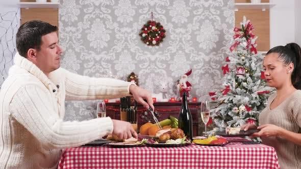 Thumbnail for Caucasian Couple Eating and Enjoying Their Christmas Dinner