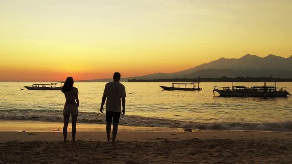 Thumbnail for Happy man and woman after marriage in love enjoy luxury on beach on sunny white sandy background 4K