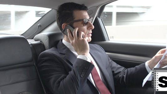 Cover Image for Businessman In Car Working