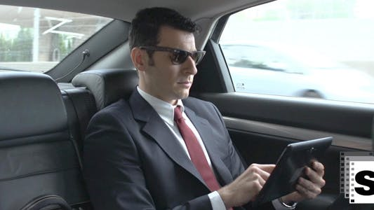 Thumbnail for Businessman In Car Using Tablet