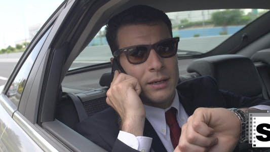 Thumbnail for Businessman In Car Using Mobile