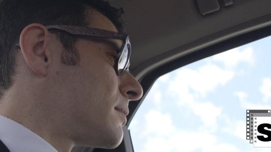 Thumbnail for Businessman Looking Outside Car Window 1