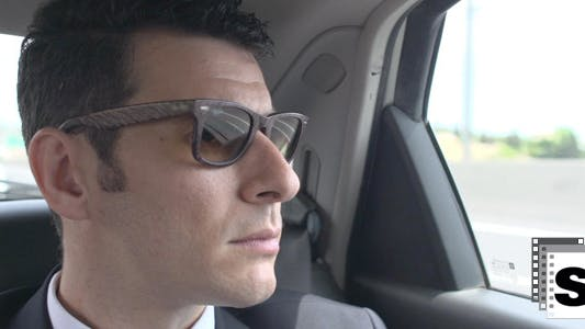 Thumbnail for Businessman Looking Outside Car Window 2