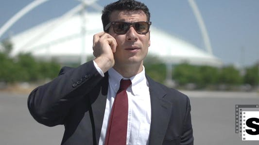 Thumbnail for Businessman Talking On His Mobile Phone