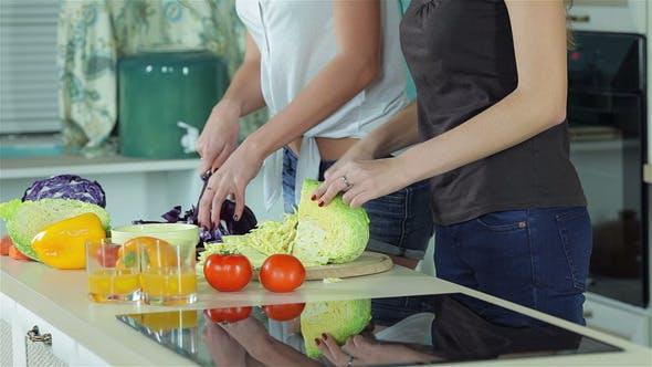 Thumbnail for Two Smiling Girlfriends Sliced Vegetables