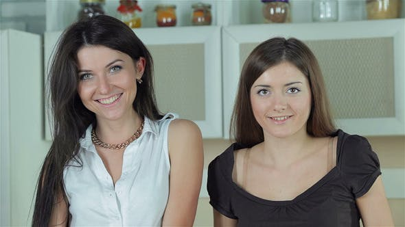 Thumbnail for Two Girlfriends Smiling Directly At The Camera