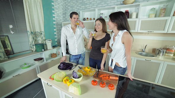 Thumbnail for Three Friends Gather To Drink Orange Fresh