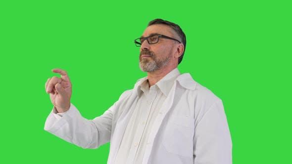 Doctor Is Touching Digital Virtual Screen on a Green Screen Chroma Key