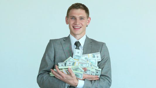Businessman With Heap of Dollars