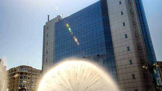 Spraying Spherical Fountain With Building
