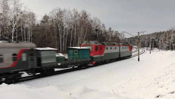 Freight Train Moving Through The Winter Forest