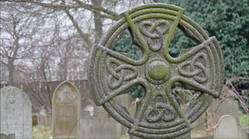 A Mossy Gravestones in the Cemetery