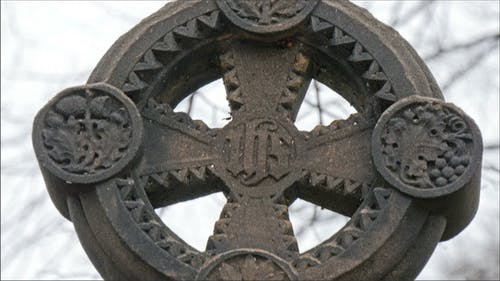 Circle with Cross Tombstone in the Cemetery