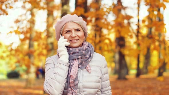 Thumbnail for Senior Woman Calling on Smartphone at Autumn Park 8