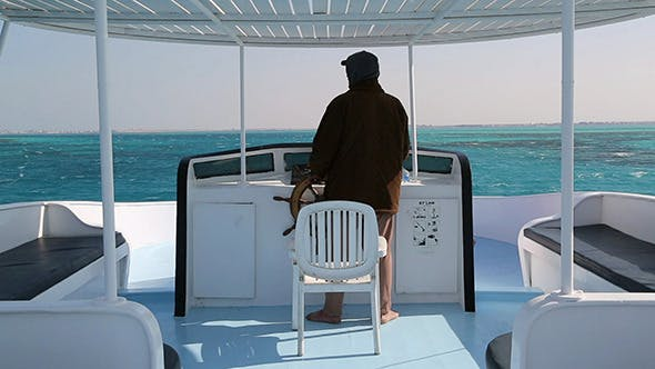 Cover Image for Captain At Controls On Yacht In Sea