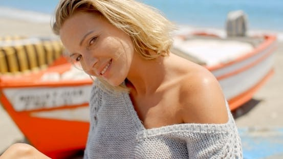 Thumbnail for Smiling Woman Wearing Grey Sweater At Beach