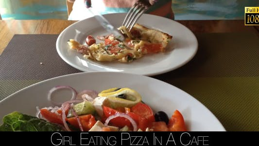 Cover Image for Girl Eating Pizza In A Cafe