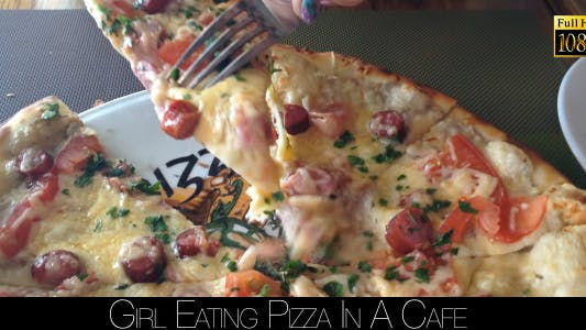 Thumbnail for Girl Eating Pizza In A Cafe 2