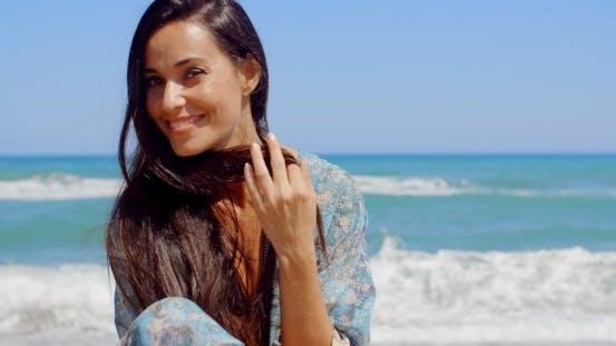 Thumbnail for Happy Woman At The Beach Looking At Camera