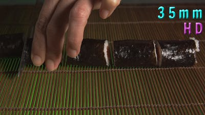 Sushi Chef Cutting Sushi Rolls 11