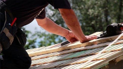 Roofers Installing Cedar Wooden Shingle Roof