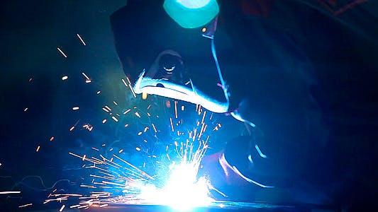 Welder Weld Metal in an Industrial Plant