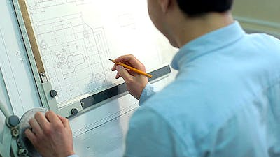 Man Draws a Technical Drawing on Drawing Board