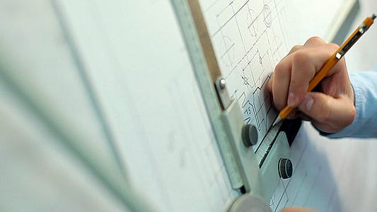 Thumbnail for Man Draws a Technical Drawing on Drawing Board