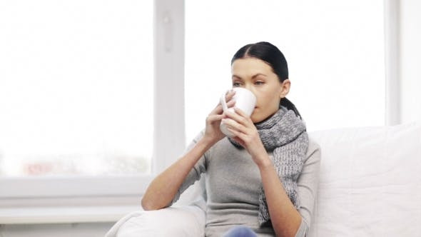 Thumbnail for Ill Woman With Flu Drinking Hot Tea At Home