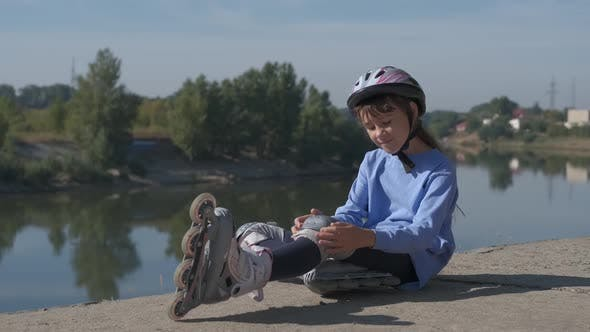 Child with roller skates.