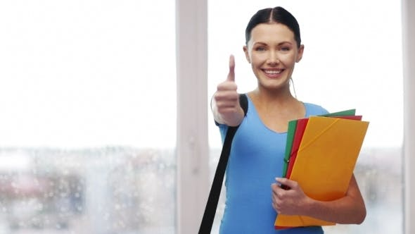 Thumbnail for Student With Bag And Folders Showing Thumbs Up