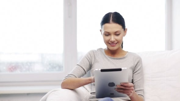 Thumbnail for Smiling Young Woman With Tablet Pc At Home