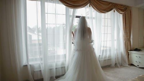 Bride Looking Through The Window