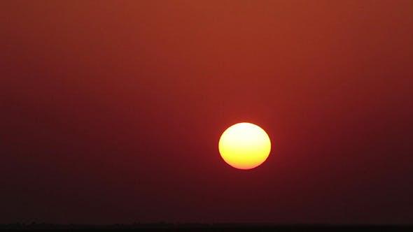 Red Sunset In Desert