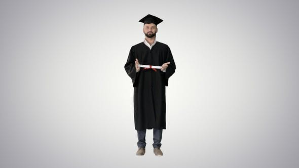 Thumbnail for Male student graduate showing diploma on gradient background.