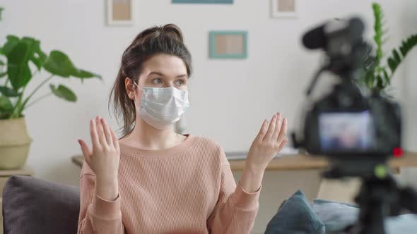 Thumbnail for Female Blogger in Medical Mask Recording Video at Home
