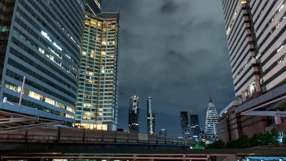 Cover Image for Time Lapse View of Skyscrapers in Business District at Night Time
