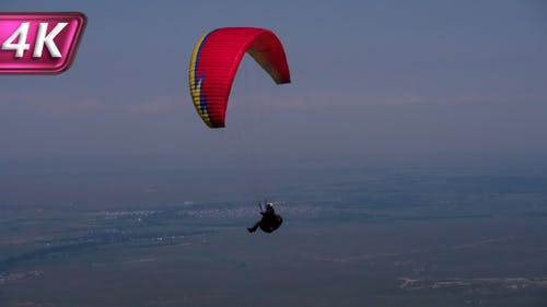 Paragliders Floating in the Air