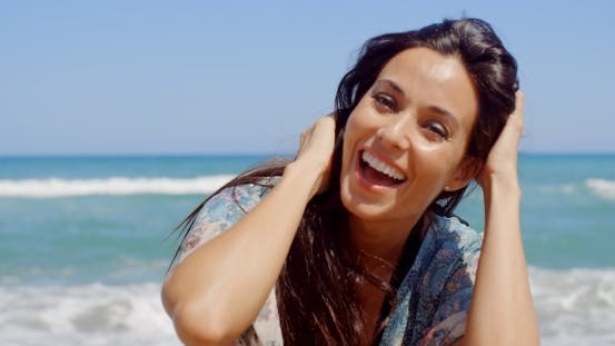 Thumbnail for Happy Woman At The Beach Looking At Camera