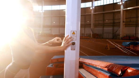 Thumbnail for Pole Vaulting - Young Woman Is Turning the Crane and Raising the Bar