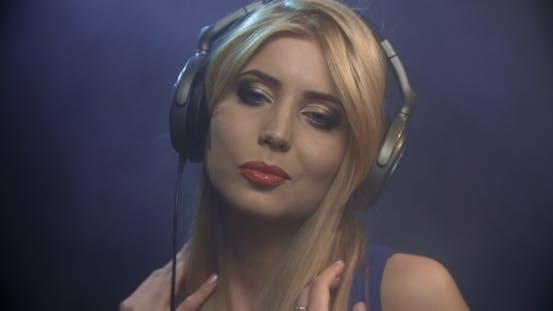 Thumbnail for Girl Listening To Music In Headphones