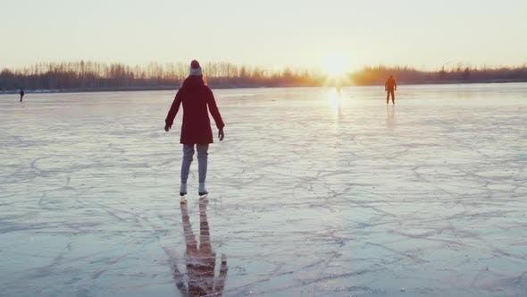 Woman Ice Skating on Frozen Lake