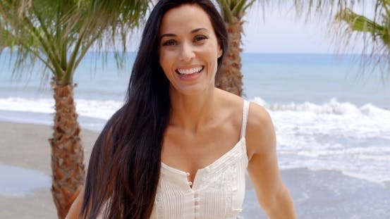 Thumbnail for Portrait Of Smiling Woman On Tropical Beach