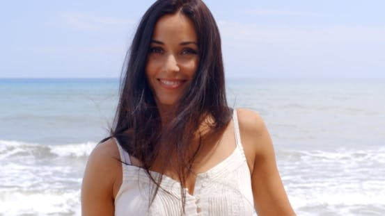 Thumbnail for Pretty Young Woman At The Beach Smiling At Camera