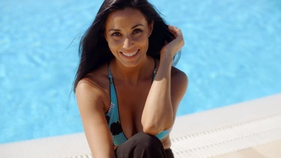 Thumbnail for Cheerful Woman At The Poolside Smiling At Camera