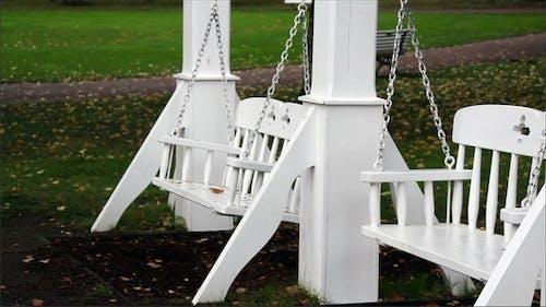 Two Bench Swings Swinging