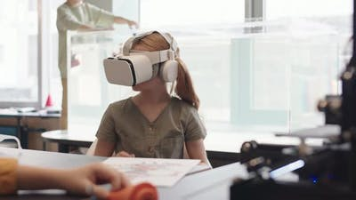 Schoolgirl Wearing VR Glasses during Science Lesson