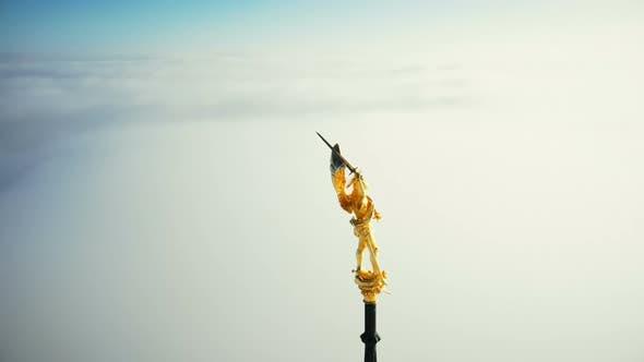 Thumbnail for Super Close-up Aerial Shot, Golden St Michael Statue on Top of Mont Saint Michel Castle Fortress