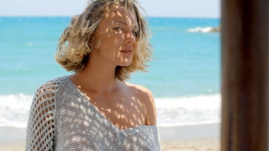 Thumbnail for Close Up Of Blond Woman In Front Of Blue Ocean