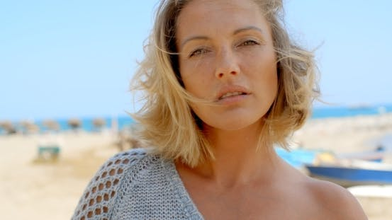 Thumbnail for Portrait Of Blond Woman Standing Near Ocean